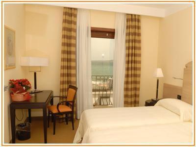 Кровать или кровати в номере Palazzo Foti Hotel