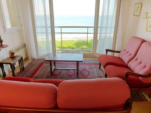 A seating area at Apartment Val