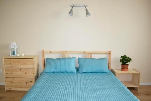 A bed or beds in a room at Apartment Yevstafyeva
