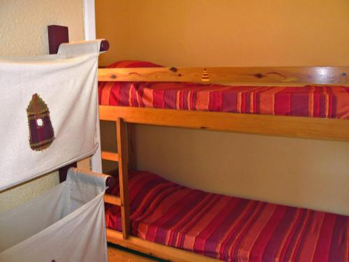 A bunk bed or bunk beds in a room at Apartment Les Coraux-3