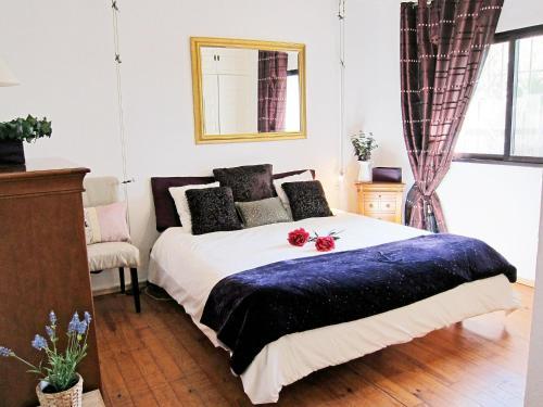 Säng eller sängar i ett rum på Villa Villa Noelia
