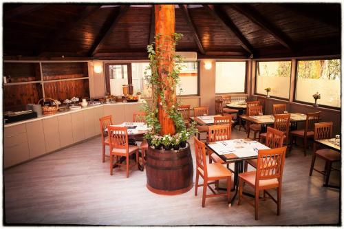 Ein Restaurant oder anderes Speiselokal in der Unterkunft Hotel d'Este