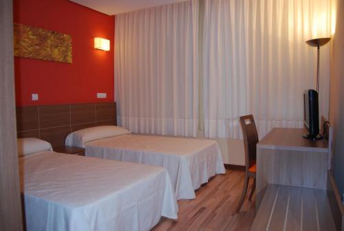 Cama o camas de una habitación en Hotel Area de Servicio Los Chopos