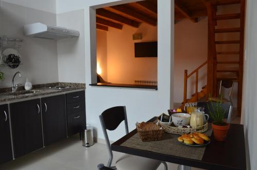 Una cocina o kitchenette en El Chalten Aparts