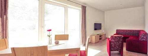 Ein Sitzbereich in der Unterkunft Ferienhaus Friedrichsmilde