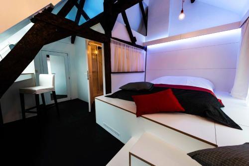 Un ou plusieurs lits dans un hébergement de l'établissement Mons Dragon House