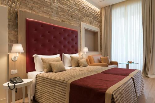 Un ou plusieurs lits dans un hébergement de l'établissement Navona Luxury Guesthouse