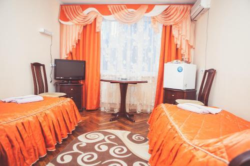 Телевизор и/или развлекательный центр в Hotel Borisoglebsk
