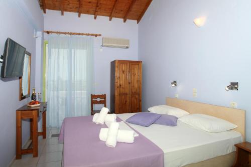 Ein Bett oder Betten in einem Zimmer der Unterkunft Summer House Louisa