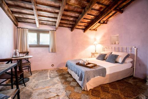 Cama o camas de una habitación en Estança La Pau - Adults Only