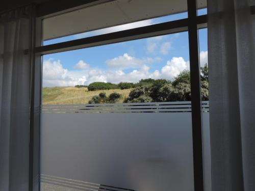 Ein Balkon oder eine Terrasse in der Unterkunft Sea & Dunes