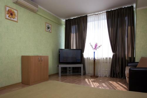 Телевизор и/или развлекательный центр в ApartLux Новоарбатская Супериор