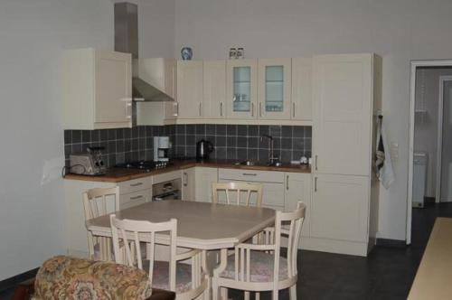 Een keuken of kitchenette bij Vino Grando Cottage