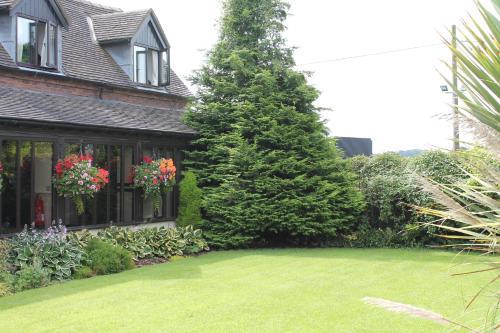 A garden outside Oak Farm Hotel