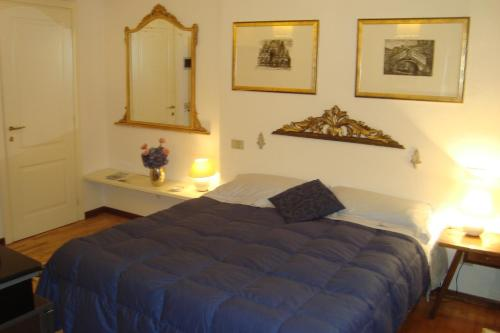 A bed or beds in a room at Le Stanze di Torcicoda