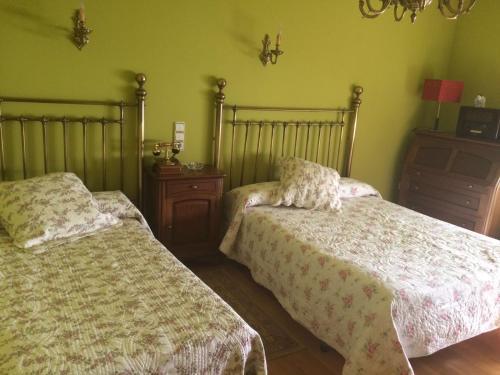 Cama o camas de una habitación en Hostal Monica