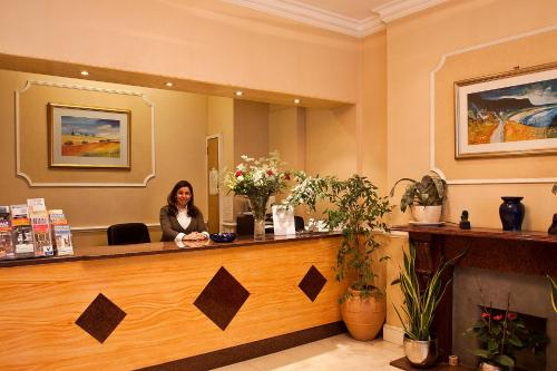The lobby or reception area at Avon Hotel