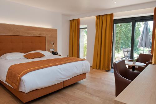 Een kamer bij Hotel Le Charme de la Semois