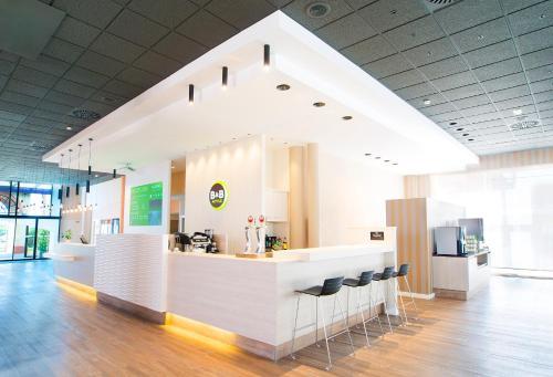 The lobby or reception area at B&B Hotel Alicante