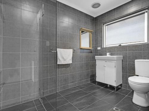 A bathroom at Adelaide Holiday Homes
