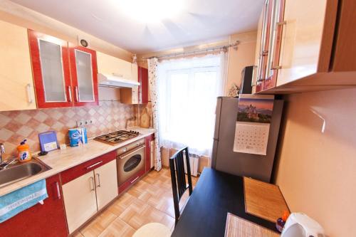 Кухня или мини-кухня в Fili Apartment