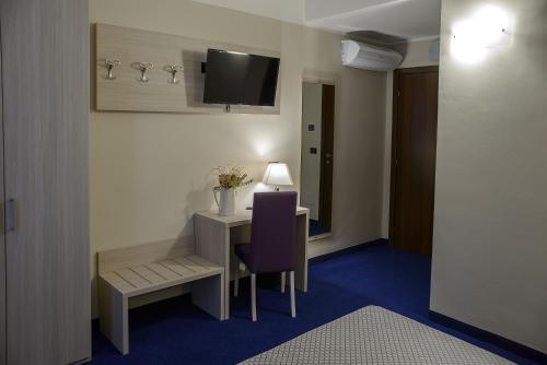Een TV en/of entertainmentcenter bij Hotel Torino Porta Susa