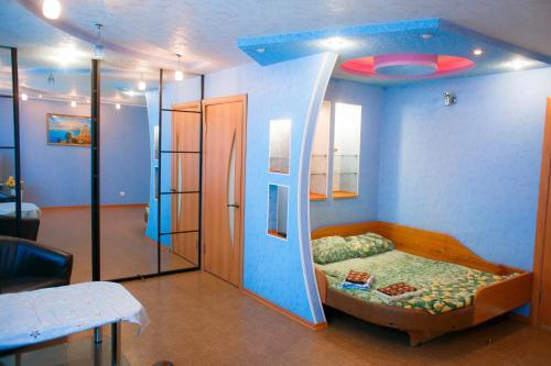 Кровать или кровати в номере Гостиница квартирного типа