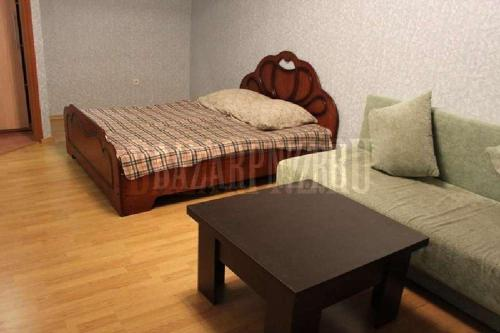 A bed or beds in a room at Apartments at Fabrichnaya