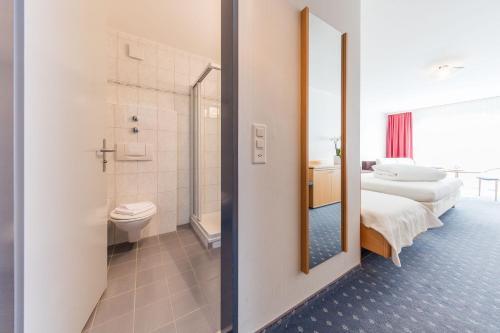 Ein Badezimmer in der Unterkunft Hotel Höfli
