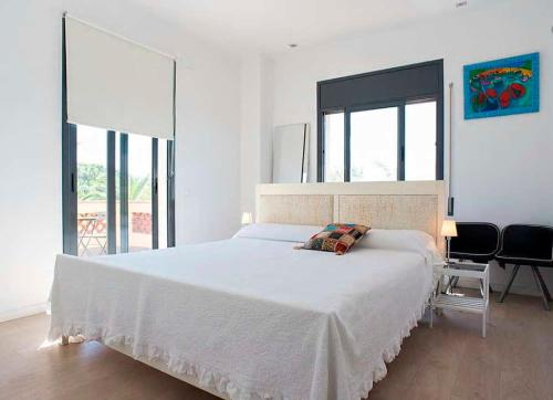 A bed or beds in a room at Tu Casa en Barcelona