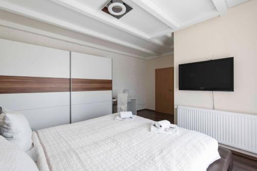 Кровать или кровати в номере Vital Hotel Adendorf
