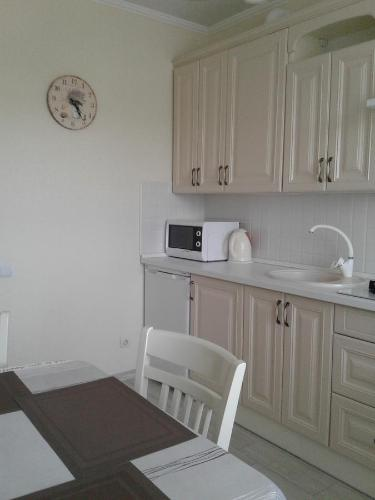 A kitchen or kitchenette at Apartments at Mayskiy proezd