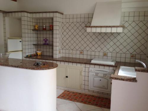 A kitchen or kitchenette at Casa Saputo