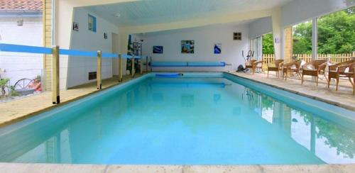 The swimming pool at or near Les Roulottes des Songes de l'Authie