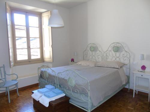 Letto o letti in una camera di Il Granaio di Palazzo Guicciardi