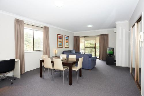 A seating area at Oxley Court Serviced Apartments