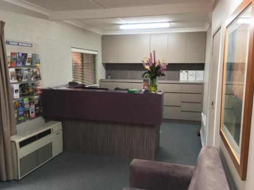 The lobby or reception area at Oxley Court Serviced Apartments