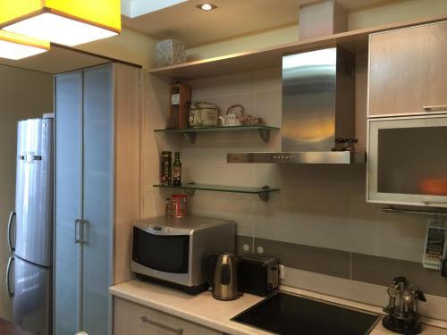 Кухня или мини-кухня в Studio in Vladivostok