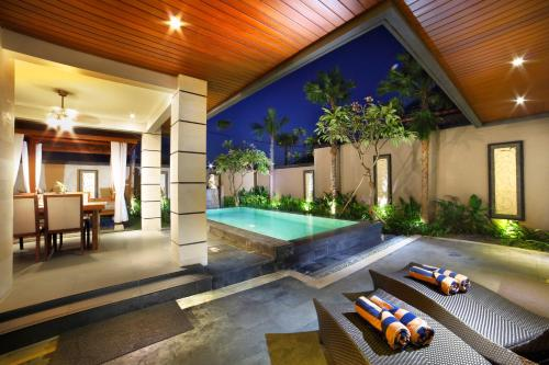The swimming pool at or close to The Banyumas Suite Villa Legian