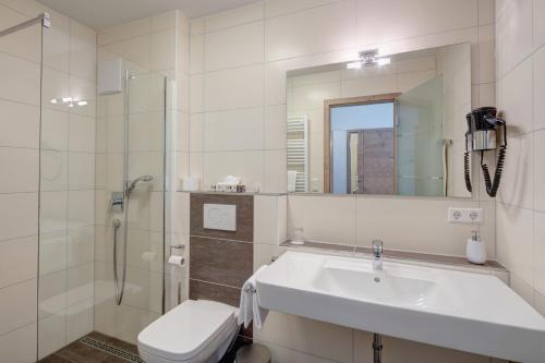 Ein Badezimmer in der Unterkunft Vinotel Heinz J. Schwab