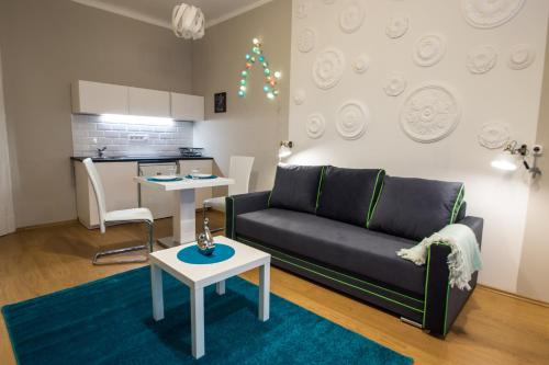 A seating area at Concept Apartments