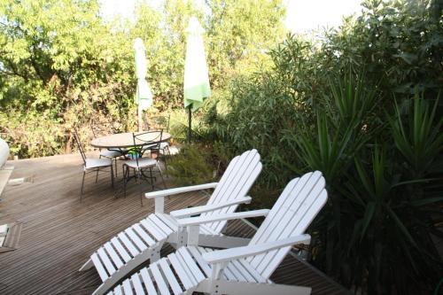 A patio or other outdoor area at La croisée des chemins