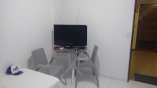 A television and/or entertainment centre at Estúdio Ibiza II