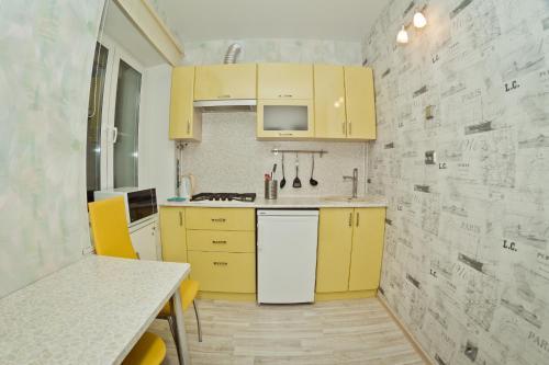 A kitchen or kitchenette at Apartments at Gorkogo