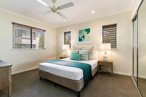 A bed or beds in a room at Montpellier Boutique Resort Noosa