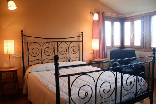 Cama o camas de una habitación en Casas Rurales El Parador