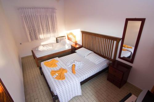 Cama ou camas em um quarto em Hotel Águas Vivas