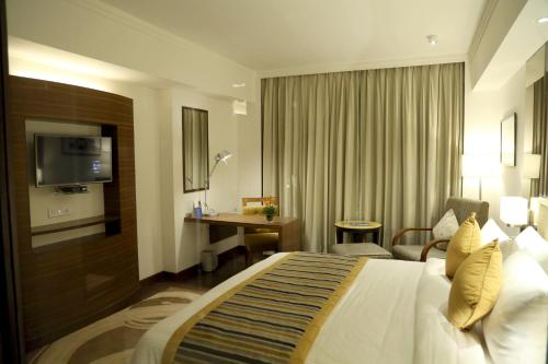 Aditya Park-A Sarovar Portico Hotelにあるお部屋