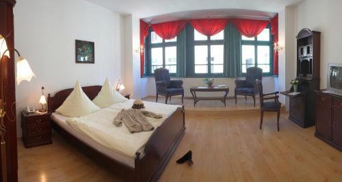 Ein Zimmer in der Unterkunft Altstadthotel Garni Schlundhaus & Rautenkranz
