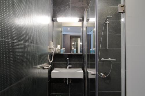 Een badkamer bij Bastion Hotel Brielle - Europoort
